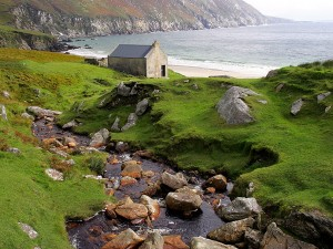 Ireland County Mayo Achill Island Atlantic Drive stone cottage on coast near Keel